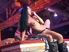 Two Chicks Tease And Fuck While On Stage